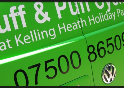 Vehicle wrap vinyl and graphic text applied as green racing stripe to back doors and bonnet of Huff and Puff Cycles VW Transporter