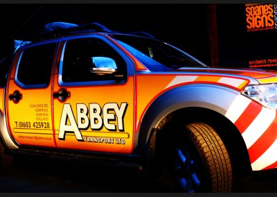 Abbey Transport Nissan Navara 4x4 wide load support vehicle with reflective vinyl graphics applied to sides, rear and bonnet