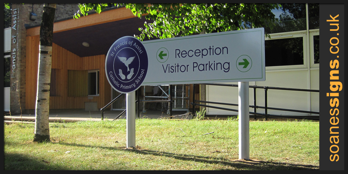 Aluminium panel with vinyl graphics, post mounted directional sign for St Francis of Assisi Catholic Primary School