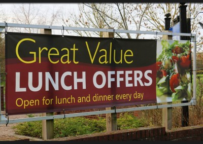 Bespoke aluminium frame on timber posts with printed banner connected with elasticated ties for The Plough restaurant