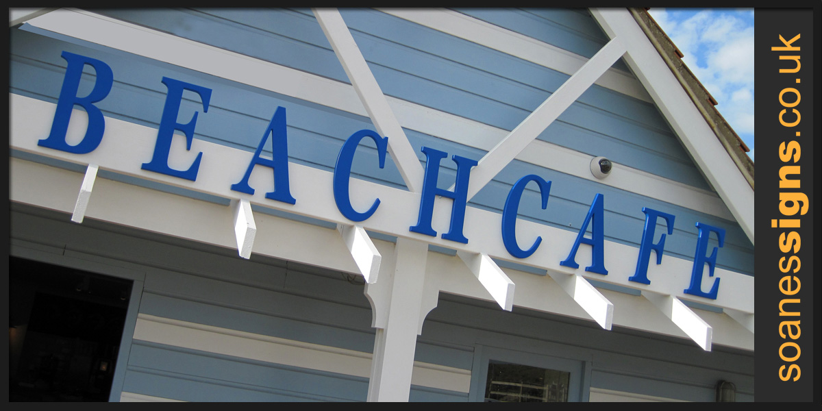 Bespoke shape cut and formed lettering attached to timber beam for Beachcafe sign