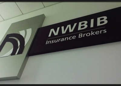 Composite panel pans with shape cut acrylic lettering and logo branding for internal NWBIB Insurance Brokers stairwell sign