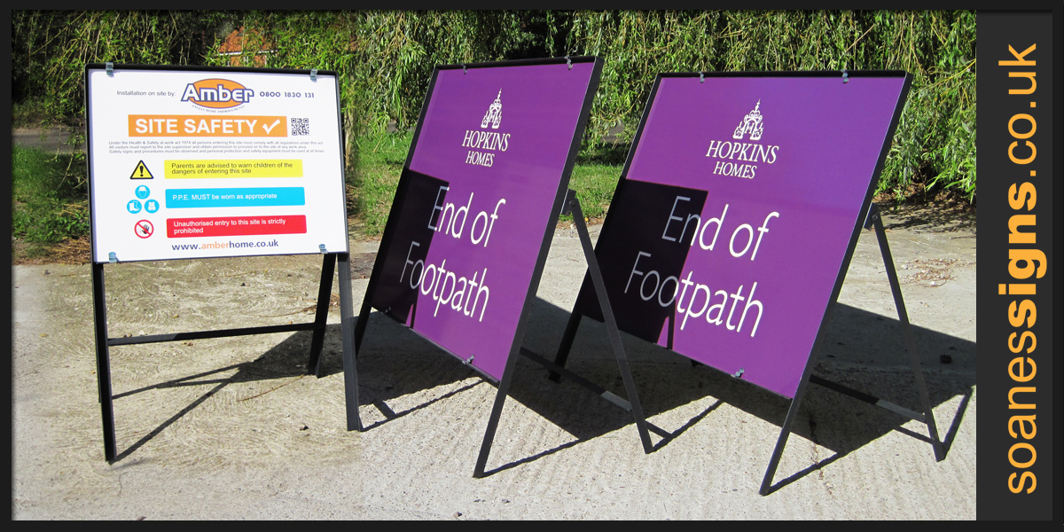 Free-standing steel frame site and road signs, Hopkins Homes and Amber Home Improvements