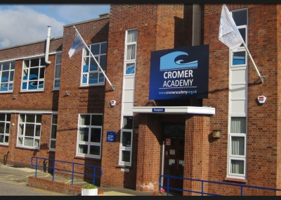 Front entrance printed signage, flags and window graphics installed as part of a full revamp of Cromer Academy