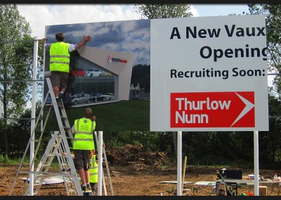 Installation of large panel multi-panel and multi-posted Vauxhall car showroom development sign with printed and applied vinyl graphics