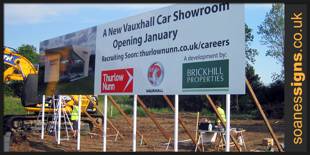 Large panel multi-panel and multi-posted Vauxhall car showroom development sign with printed and applied vinyl graphics