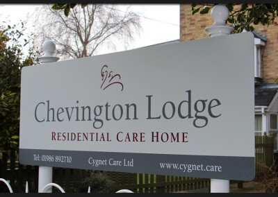 Powder coated aluminium post mounted sign with vinyl graphics applied to the panel for Cygnet Care Chevington Lodge