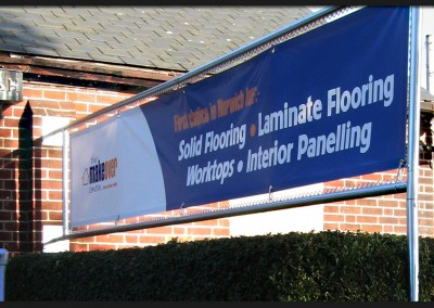 Printed banner within bespoke made stainless steel tube frame with elasticated ties for The Makeover Centre Norwich