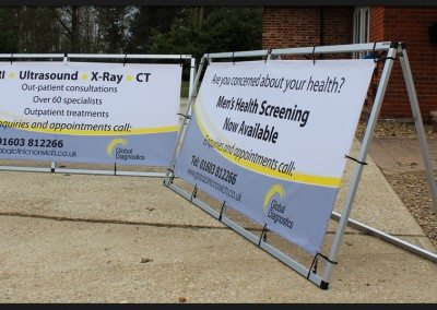 Printed banners installed within free standing metal A-frames with elasticated ties for Global Diagnostics Norwich