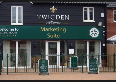 Printed graphic panels, pavement swinger signs with shape cut acrylic lettering for Twigden Homes marketing suite