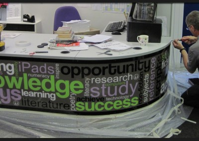 Printed inspirational graphic with clear Perspex cover installed around curved desk for Dereham Northgate High School