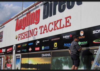 Printed vinyl  graphics applied to panels along with shape cut acrylic lettering on off-stands to Anglia Direct Fishing Tackle shop