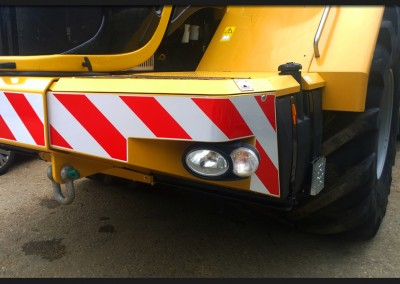 Reflective and red vinyl chevrons, templated and made for the front of O Arnold Teragator