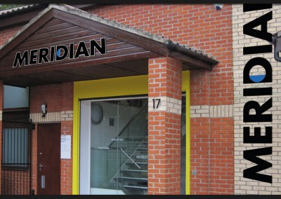 Shape cut acrylic lettering to building front, brick and timber connection with vinyl graphics applied to glazed doors and screen for Meridian Interiors
