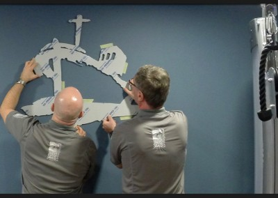 Shape cut acrylic for internal wall logo branding of Pinewoods gym Holkham