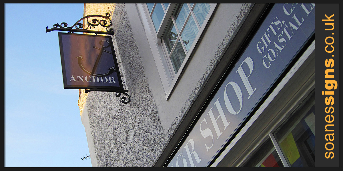 Shop front facia and swinger sign, design and printed graphics of vinyl for The Anchor Shop Blakeney