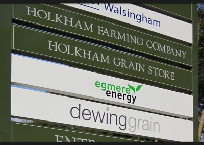 Site directory sign with shaped and powder coated aluminium panels with reflective and applied graphics attached to square posts installed for Holkham Farming Company