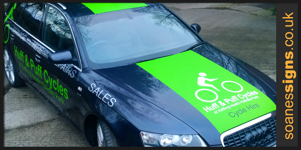 Vehicle wrap vinyl applied as green full racing stripe to bonnet roof and boot of Huff and Puff Cycles Audi A6 along with branding vinyl graphic