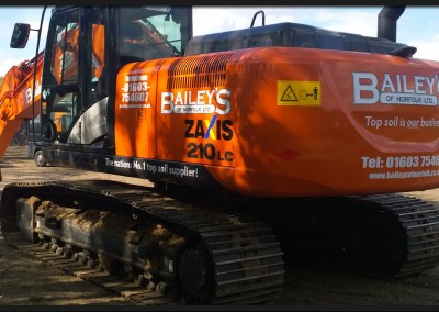 Vinyl branding graphics applied to Baileys of Norfolk Hitachi 210
