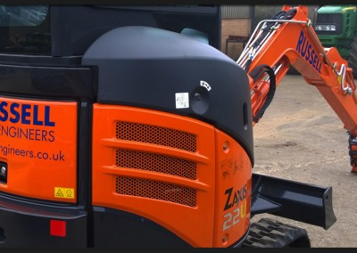 Vinyl branding graphics applied to Russell Civil Engineering Hitachi mini-digger