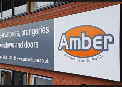 Backlit flex-face sign, stretched printed material over aluminium frame and LED backlight, installed for Amber Home Improvements