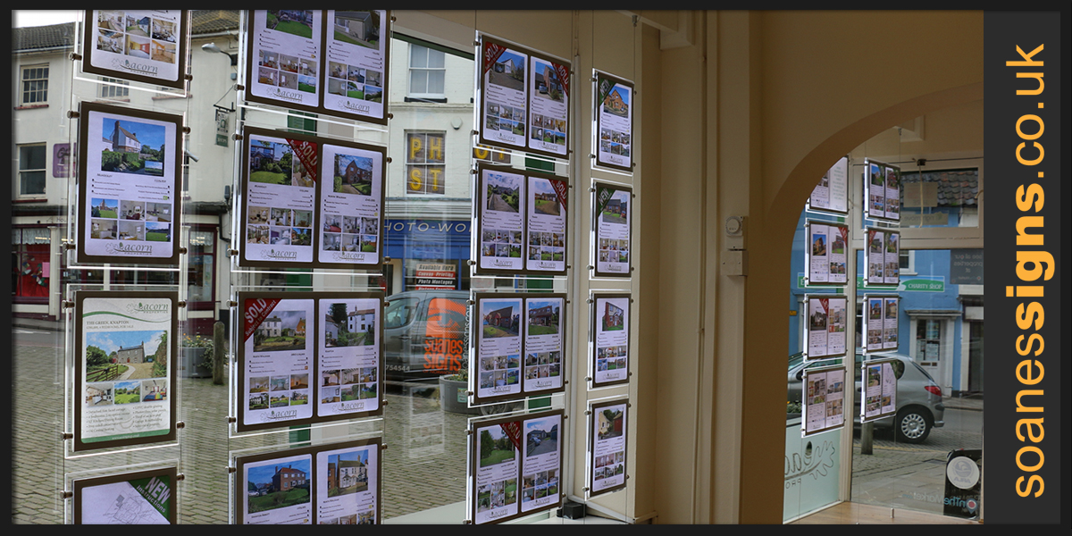 Double sided backlit LED light panels for estate agent window display, with supporting timber beam, at Acorn Properties