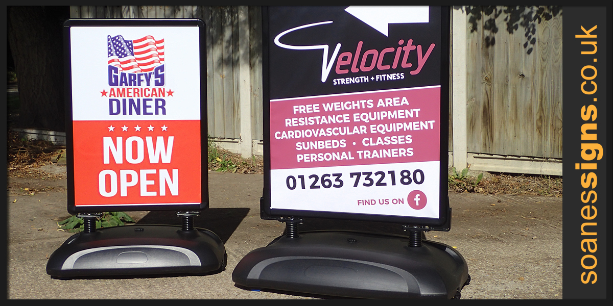 Heavy duty pavement signs with poster clip frames, water filled base and size options