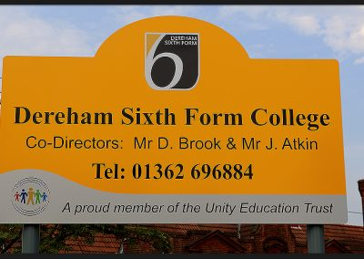 School signs, shape top aluminium panel on rails with print and cut vinyl graphics, installed on aluminium posts for Dereham Sixth Form College