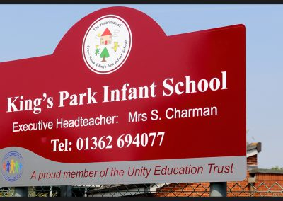School signs, shape top aluminium panel on rails with print and cut vinyl graphics, installed on aluminium posts for Kings Park Infant School