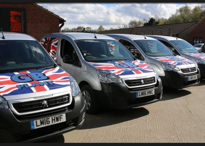 Fleet vans with printed and cut vinyl vehicle graphics on Peugeot Partner for GB Plant
