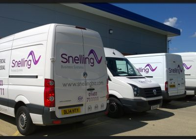 Fleet vans with printed and cut vinyl vehicle graphics on VW Crafters and Ford Transits for Snelling Business Systems