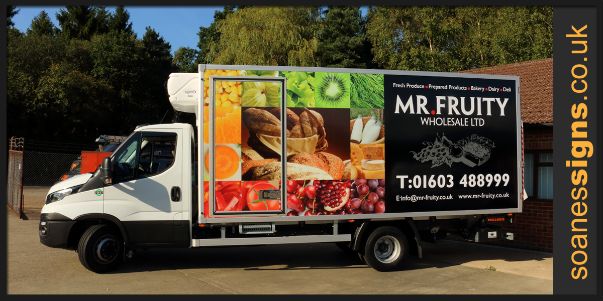 Full vinyl print applied to the box sides of Mr Fruity Iveco Truck with supporting vinyl brand graphics