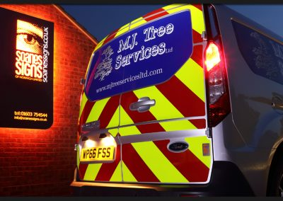 Reflective vinyl chevrons kit, with printed and cut vinyl graphics applied to MJ Tree Services Ford Transit Connect