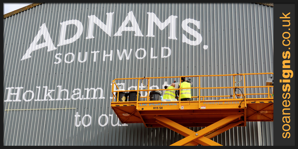 White vinyl graphics applied to corrugated cladding on Hangar Barn for Adnams of Southwold